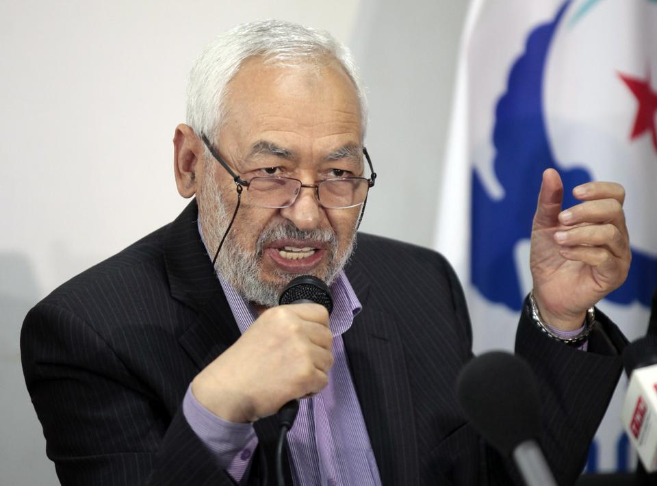 Ghannouchi, head of the governing Ennahda party, gives a press conference in Tunis, in December 2012. After long persecution at the hands of the the country's secularist rulers, the movement was able to come to power following the 2011 Tunisian Uprising.