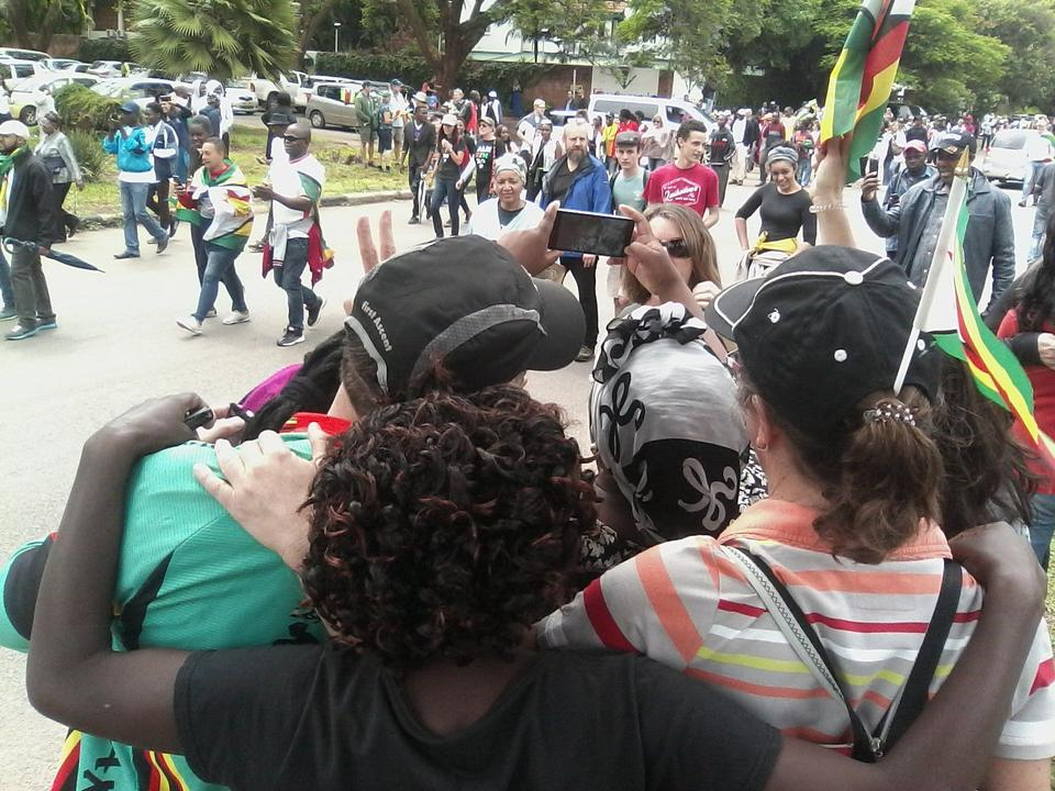 Marchers recording the historic moment as they march towards the State House.