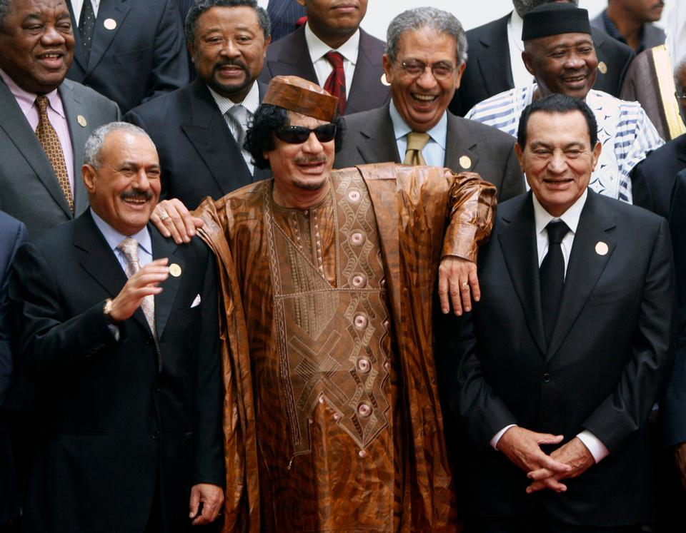 In this October 10, 2010 file photo, Libyan leader Moammar Gadhafi (C) with Egyptian President Hosni Mubarak (R) and his Yemeni counterpart Ali Abdullah Saleh (L) pose during a group picture with Arab and African leaders during the second Afro-Arab summit in Sirte, Libya.