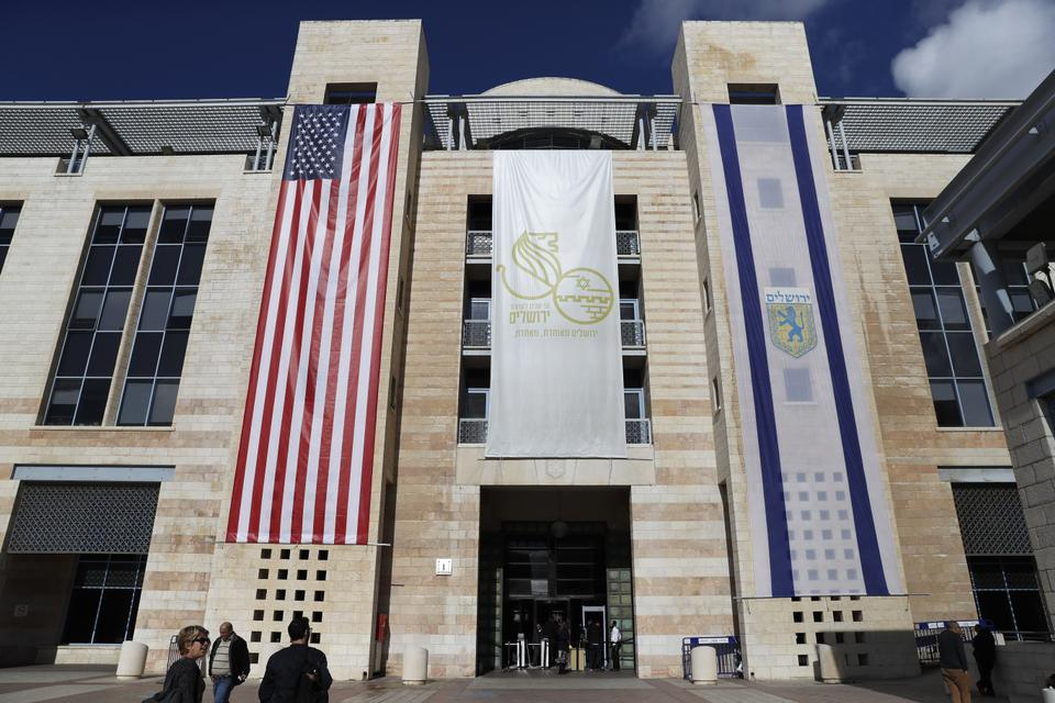 The US and Israeli flags hang at the entrance of Jerusalem Municipality building on Thursday.