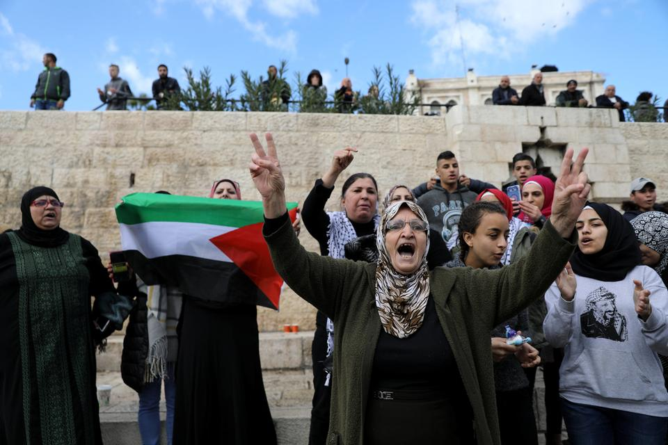 Women also took part in the protests. In this picture they shout slogans near Damascus Gate in Jerusalem's Old City December 7, 2017.