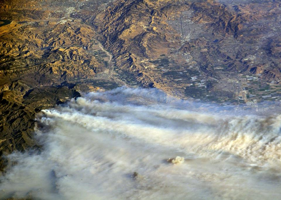 A photo taken from the International Space Station and moved on social media by astronaut Randy Bresnik shows smoke rising from wildfire burning in Southern California, US, December 6, 2017.