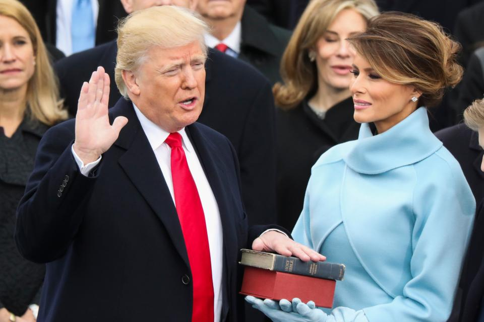 Donald Trump is sworn in as the 45th president of the United States as Melania Trump looks on during the 58th Presidential Inauguration at the US Capitol in Washington DC.