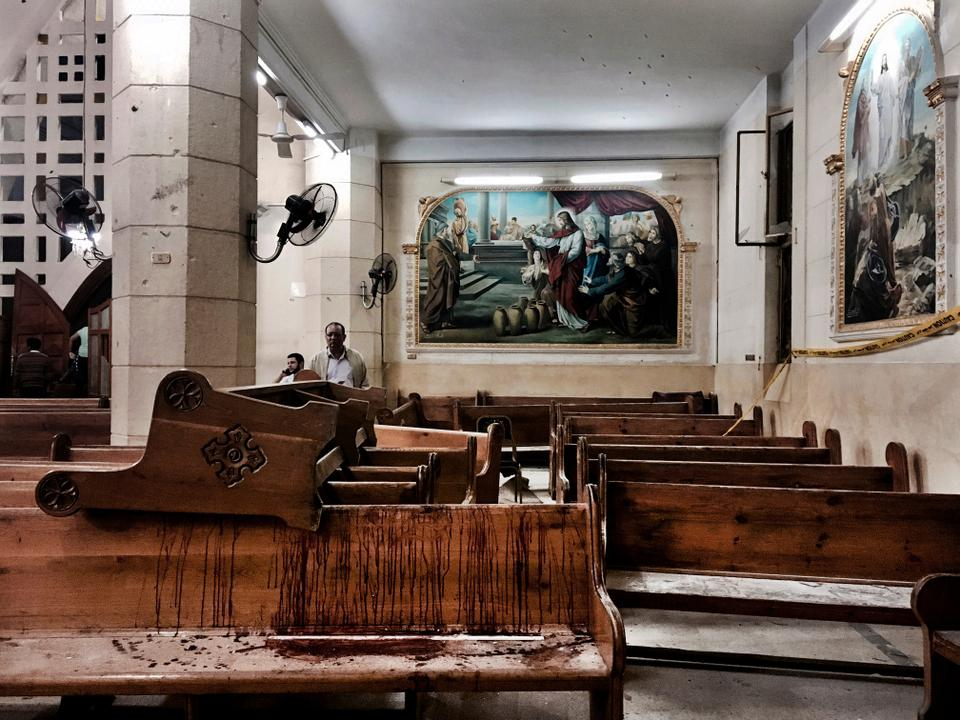 Blood stains on pews inside the St George Church after a suicide bombing in the Nile Delta town of Tanta, Egypt.