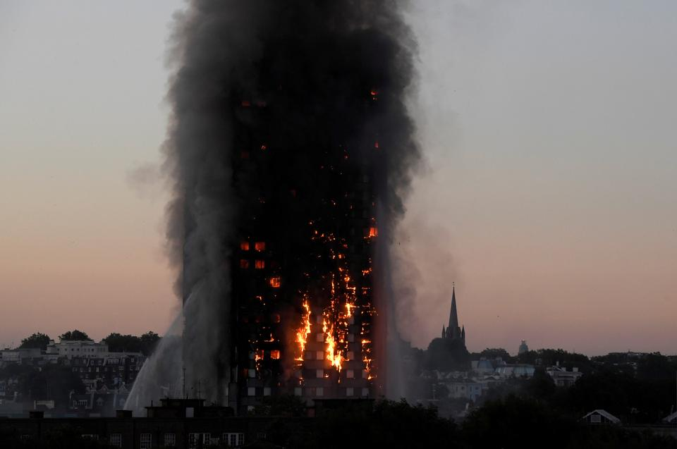 Flames and smoke billow as firefighters deal with a fire in the Grenfell Tower apartment block in West London. The remains of the tower are due to be dismantled towards the end of 2018.