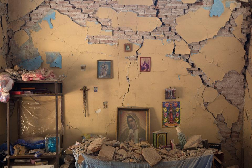 An altar to the Virgin of Guadalupe inside an earthquake-damaged home in Juchitan, Oaxaca state, Mexico.
