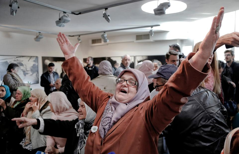 A Bosnian woman reacts to news of the guilty verdict against former Bosnian Serb military chief Ratko Mladic, in Potocari, near Srebrenica, Bosnia.