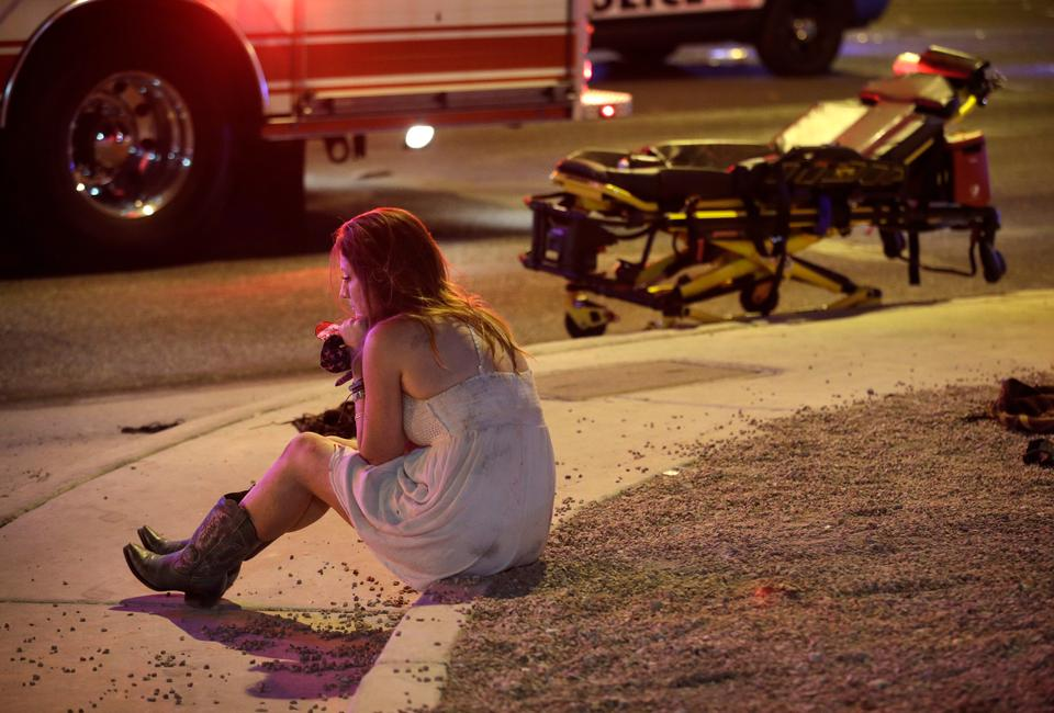 A woman near the scene of a shooting at a music festival on the Las Vegas Strip, in Las Vegas.
