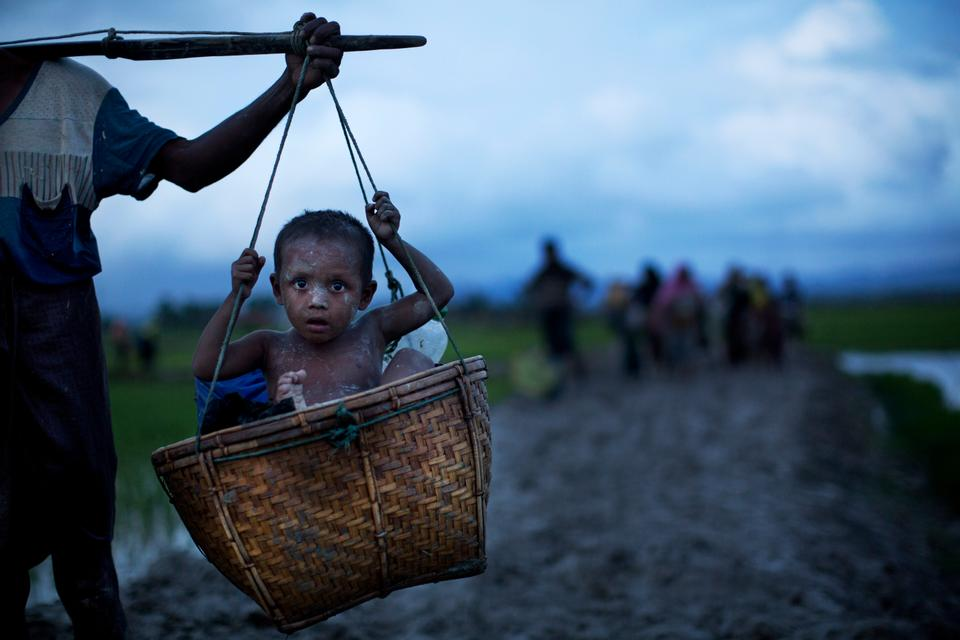 Rohingya refugees from Myanmar after crossing into Bangladesh near Cox's Bazar.