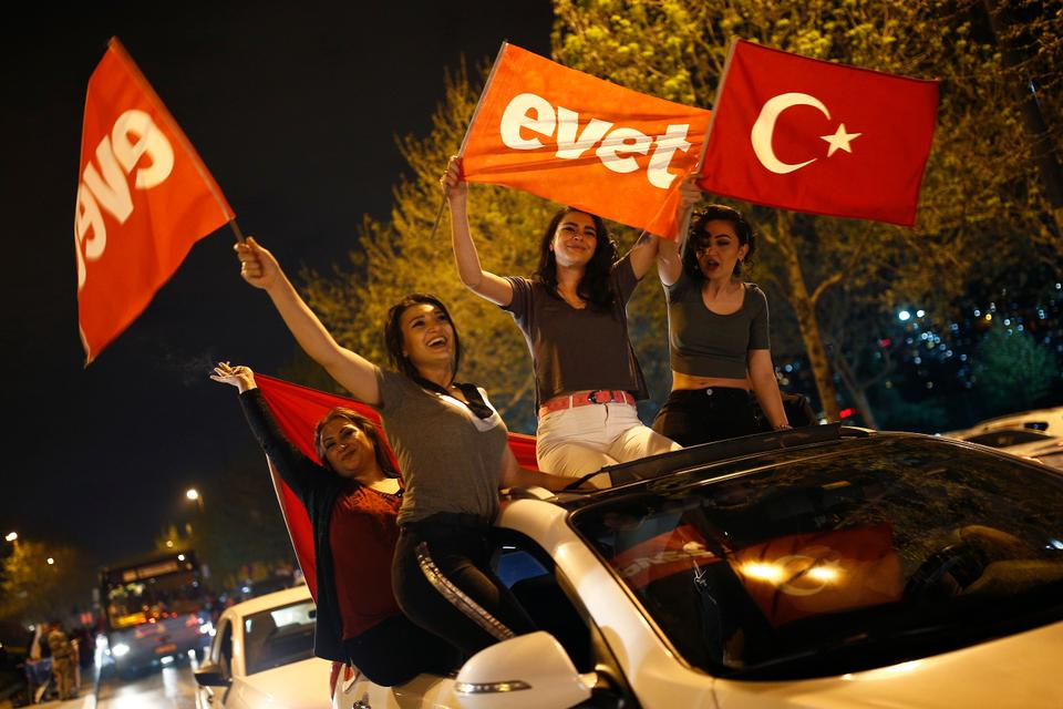 Supporters of the 'Yes' vote celebrate the referendum result in Istanbul.