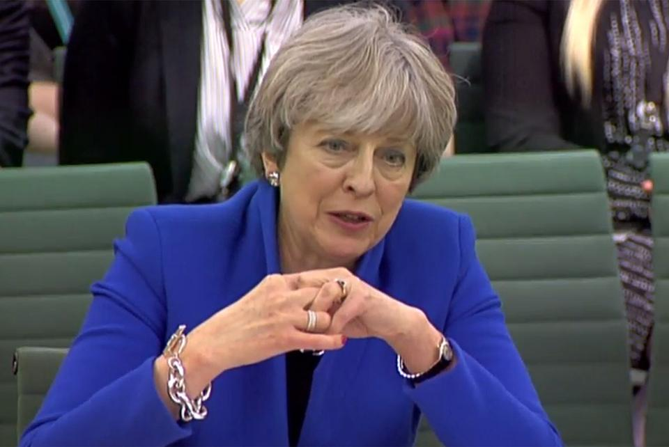 A video grab from footage broadcast by the UK Parliament's Parliamentary Recording Unit (PRU) shows Britain's Prime Minister Theresa May giving evidence to the Liaison Committee at the Houses of Parliament in central London on December 20, 2017.