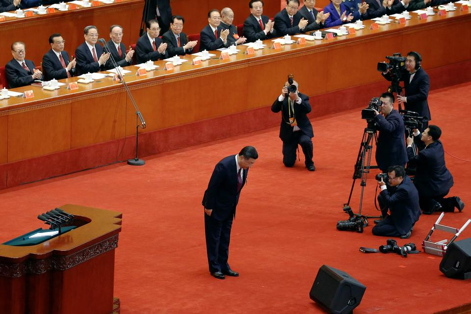 Chinese President Xi Jinping bows during the opening session of the 19th National Congress of the Communist Party of China, in Beijing, China, October 18, 2017.