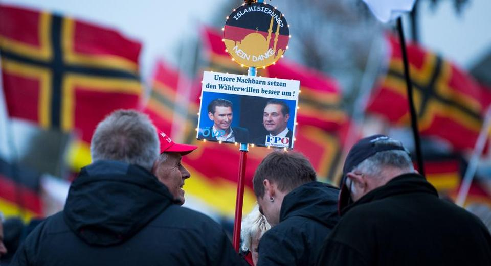 "Pegida, an abbreviation of the Patriotic Europeans Against the Islamisation of the West, a group that emerged in Germany celebrates the third anniversary of their movement. In the placard a picture of the right-wing Sebastian Kurz, the new Chancellor of Austria and his coalition partner Heinz-Christian Strache of the extreme right-wing FPO leader. The placard says ""Our neighbours realise the will of the electorate better."" Also on the placard is ""Islamisation, no thanks."""