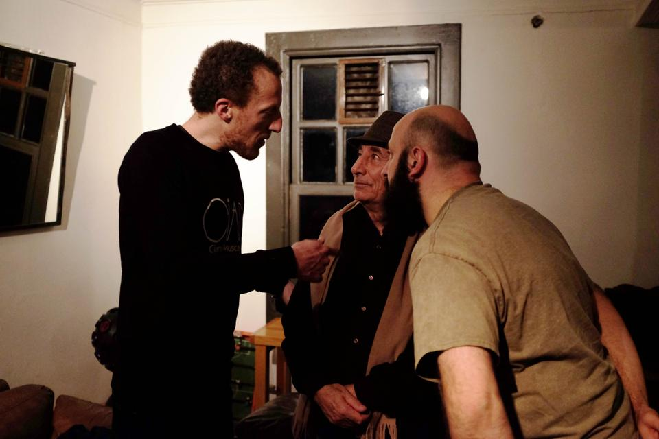 Doug Shipton (L), co-founder of Finders Keepers Records, talks to another artist on the label's roster, Mustafa Ozkent (centre), a good friend of Gokcen Kaynatan, in Istanbul.
