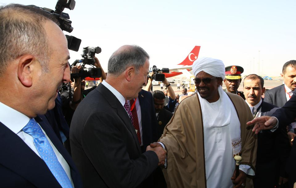 Some pro-government Egyptian media outraged by Turkey's Chief of Staff Hulusi Akar's (middle) visit to Sudan, described it as