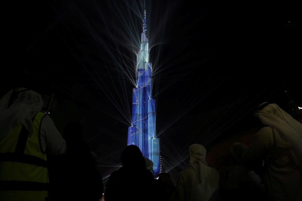 Dubai hosted one of the largest light and sound shows on a single building as thousands gathered around Burj Khalifa for the emirate's first New Year's Eve laser show.