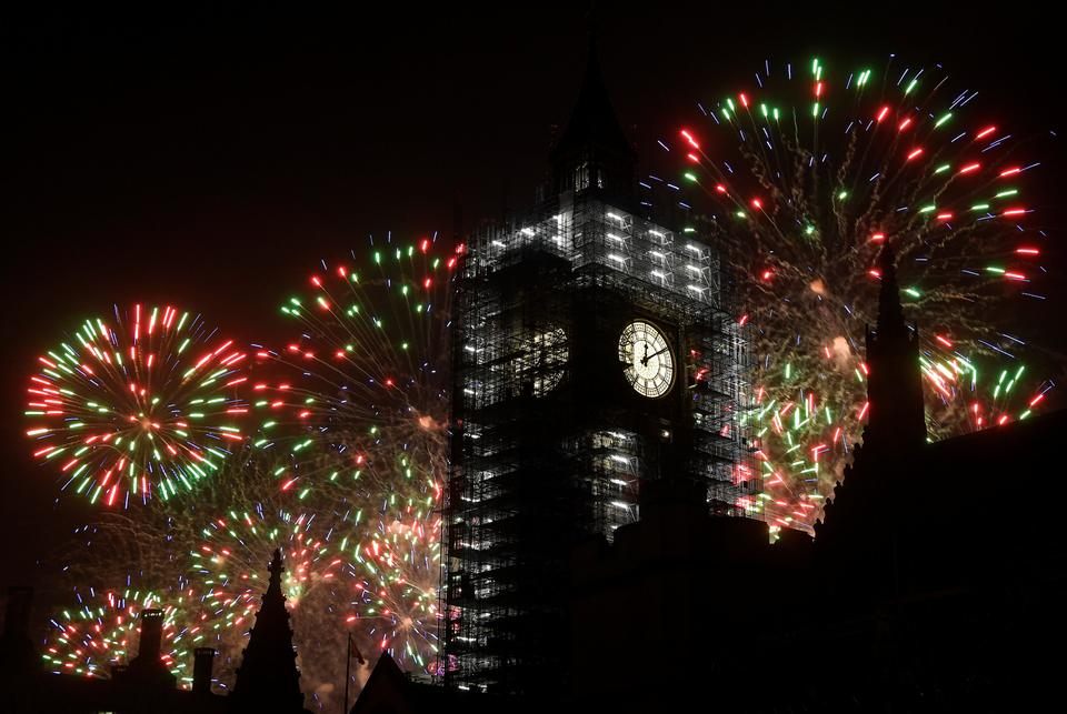 At least 100,000 people watched London's midnight firework show from the banks of the River Thames.