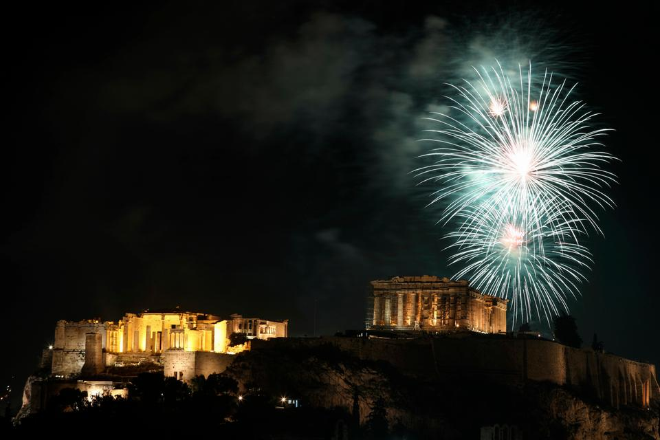 Fireworks explode over the 2,500-year-old ancient Parthenon temple atop the Acropolis hill during New Year's day celebrations in Athens