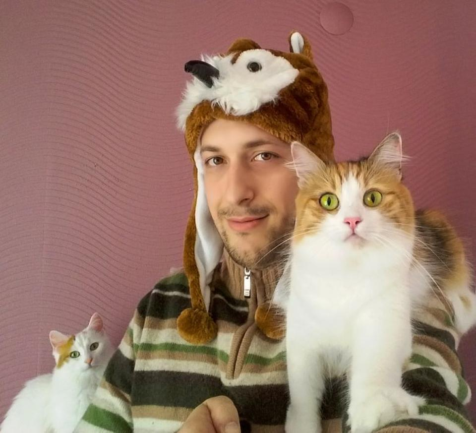Batu Aksoy, who started the online petition, with his cats. [Photo courtesy: Batu Aksoy]