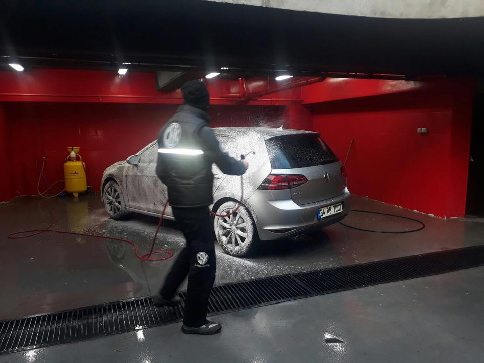 Abdulghaffar, a Syrian refugee works at a car wash center in Istanbul, is washing a car, January 12, 2017.