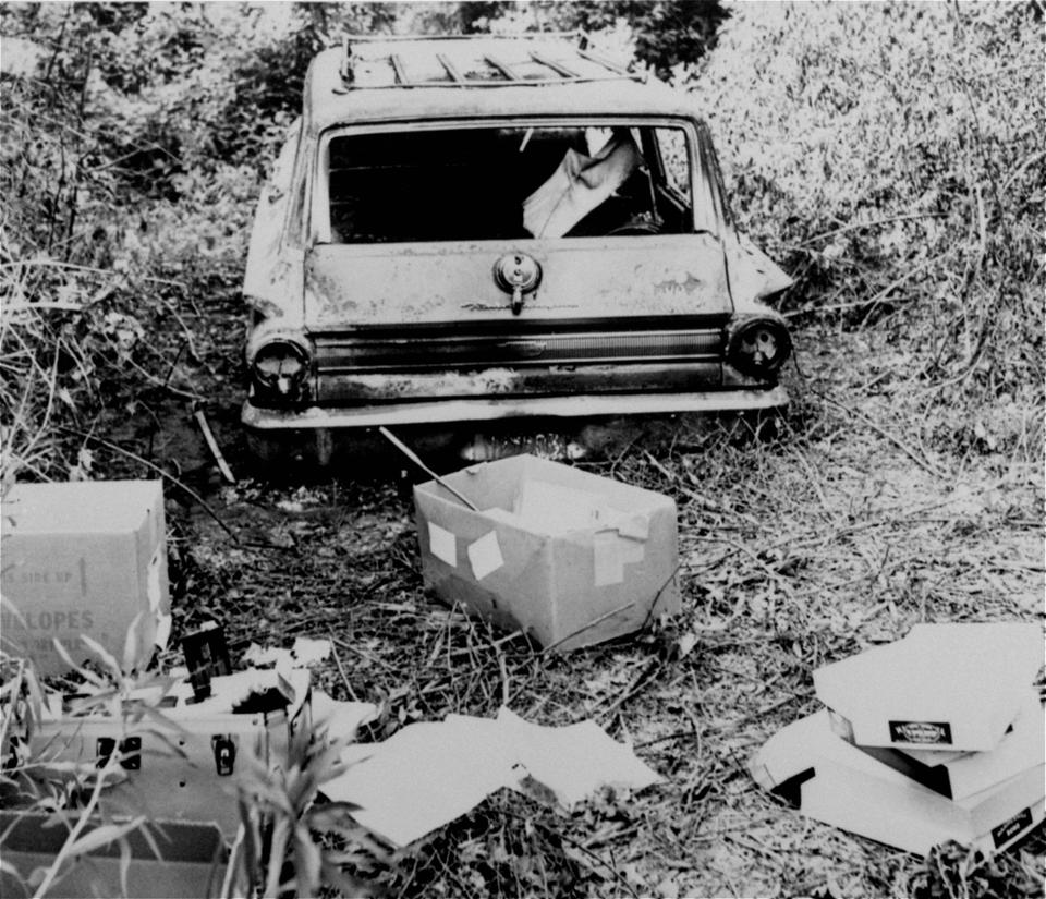 This June 24, 1964 file photo shows the burned station wagon of three missing civil rights workers, Michael Schwerner, Andrew Goodman, and James Chaney, in a swampy area near Philadelphia, Mississippi. The bodies of the men were found later in an earthen dam.