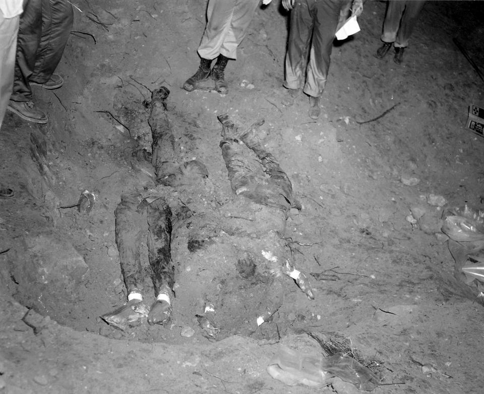 In this 1964 file photo released by the FBI, the bodies of three civil rights workers are uncovered from an earthen dam southwest of Philadelphia, Miss. The photograph was entered as evidence by the prosecution in the trial of Edgar Ray Killen.