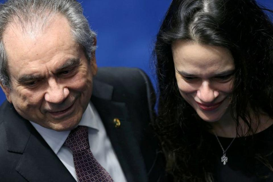 Senator Raimundo Lira speaks with Brazilian jurist Paschoal during a final session of debate and voting on suspended Rousseff's impeachment trial in Brasilia.