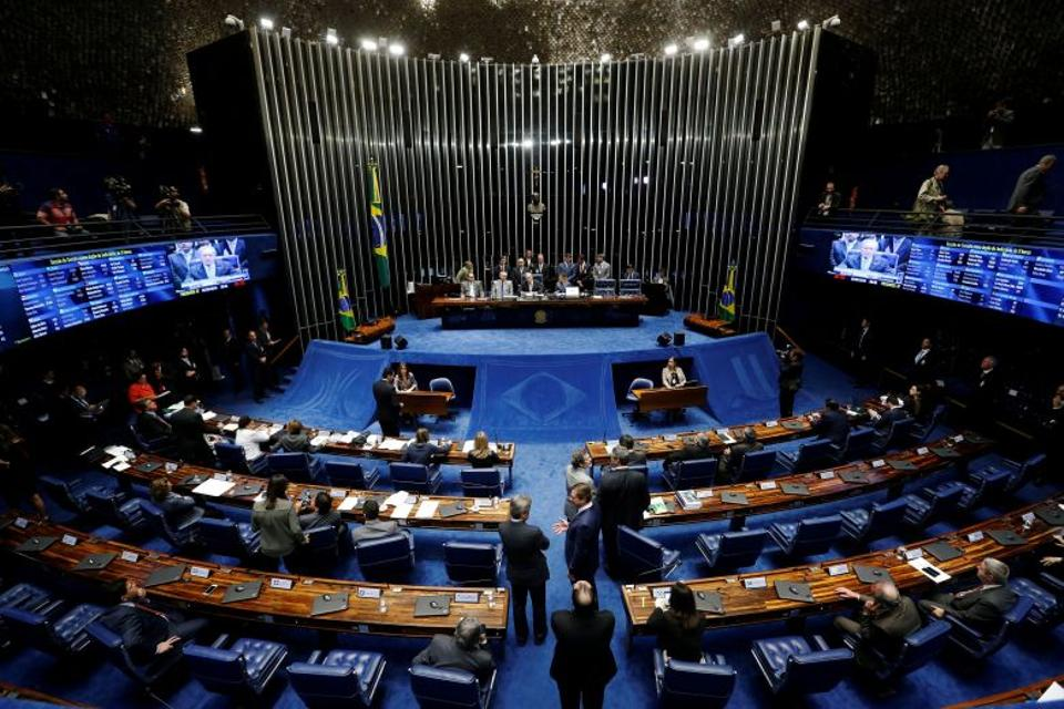 President of Brazil's Supreme Court, Ricardo Lewandowski and Brazil's Senate President Renan Calheiros speak during a discussion before the Senate votes on whether suspended President Dilma Rousseff should stand trial for impeachment, in Brasilia, Brazil.