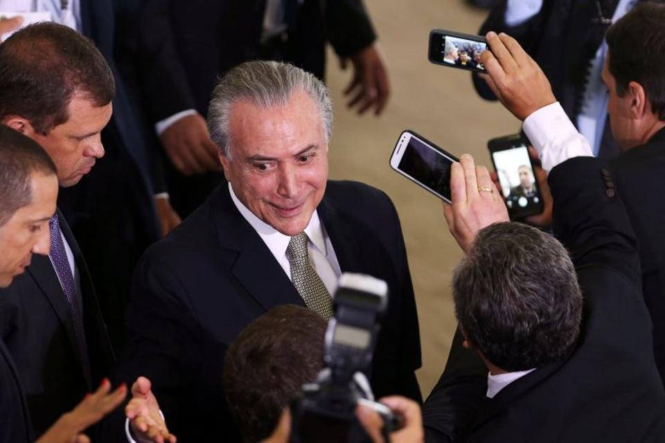 Brazil's interim President Michel Temer reacts during a meeting with representatives of the construction industry at Planalto Palace in Brasilia, Brazil, August 11, 2016.