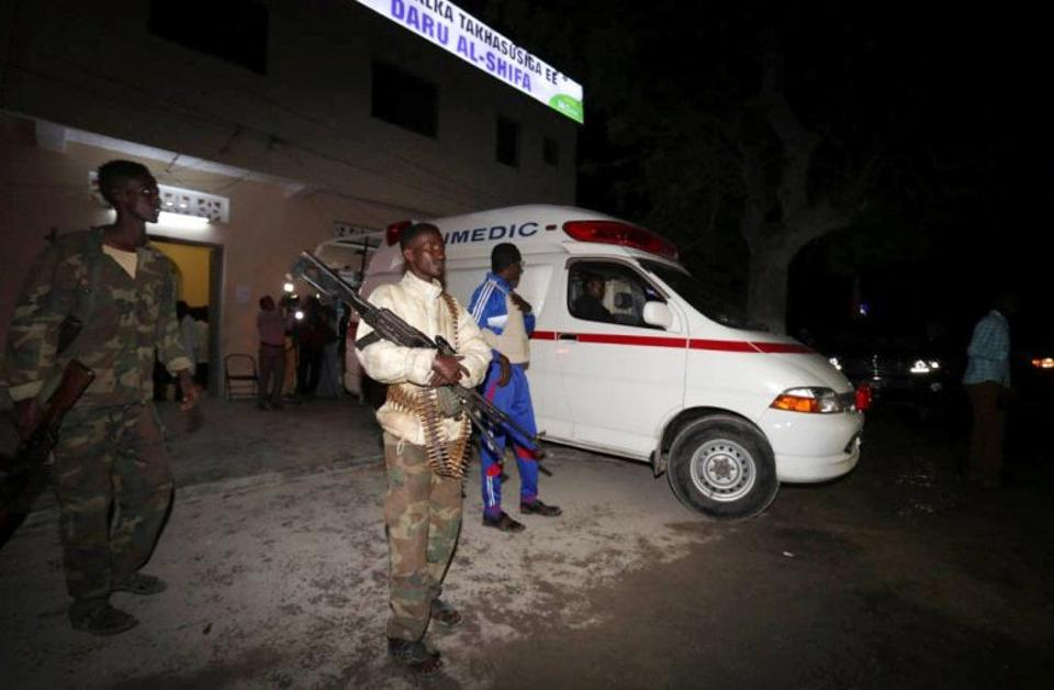 Somali policemen stand guard outside Daru Shifa hospital near an ambulance ferrying an Al-Shabaab fighter injured during an exchange of gunfire in Mogadishu on August 25, 2016.