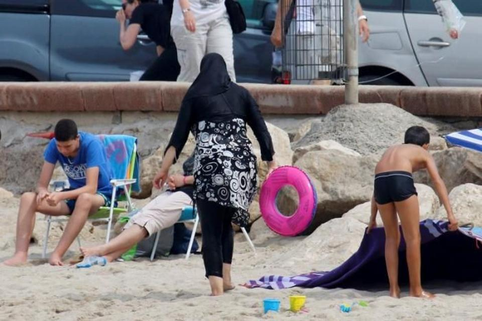 A Muslim woman wears a burkini – a swimsuit that leaves only the face, hands and feet exposed – on a beach in Marseille, France, August 17, 2016. (Reuters)