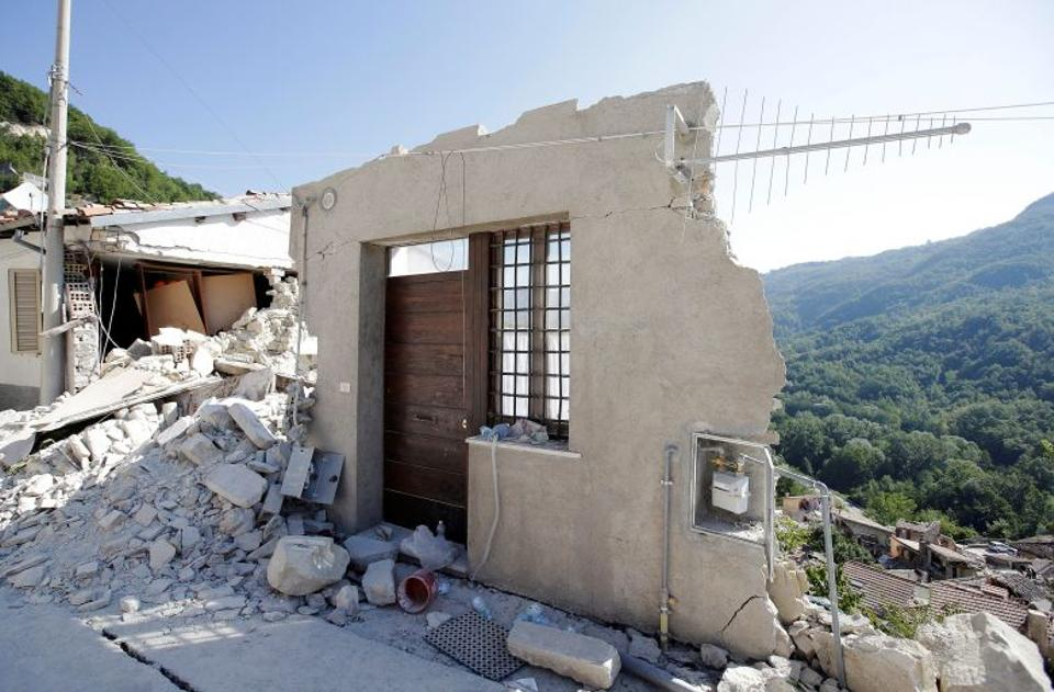 A front door of a collapsed house is seen following an earthquake in Pescara del Tronto, central Italy, August 26, 2016.