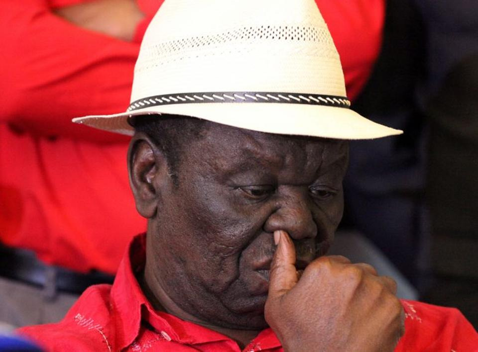 Zimbabwe opposition party leader Morgan Tsvangirai gestures during a press briefing in Harare.