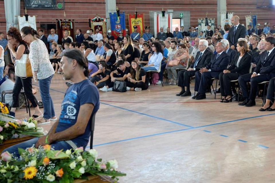 Italian President Sergio Mattarella (C) attends a funeral for the earthquake victims inside a gym in Ascoli Piceno, Italy August 27, 2016.