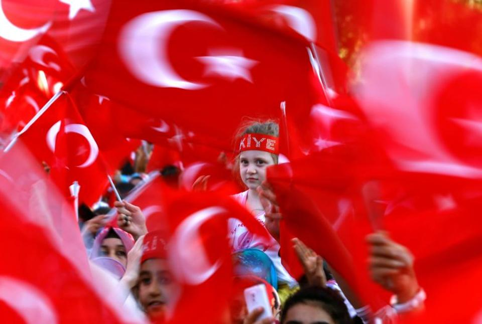 People wave national flags as they wait for Turkey's President Tayyip Erdoğan arrival to the United Solidarity and Brotherhood rally in Gaziantep, Turkey, August 28, 2016.