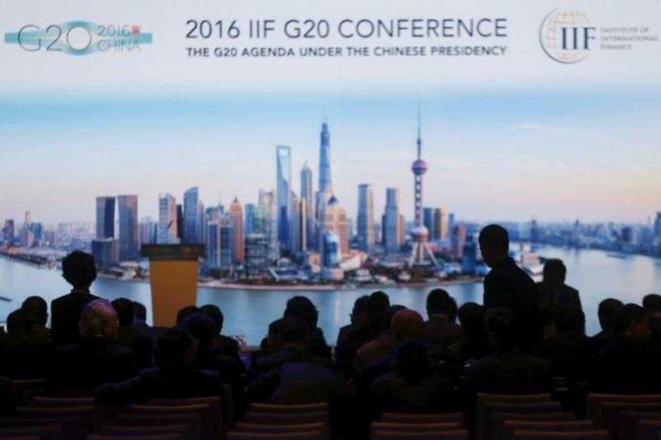 Pepole attend the 2016 IIF G20 Conference at the financial district of Pudong in Shanghai, China, February 25, 2016. Image: Reuters.