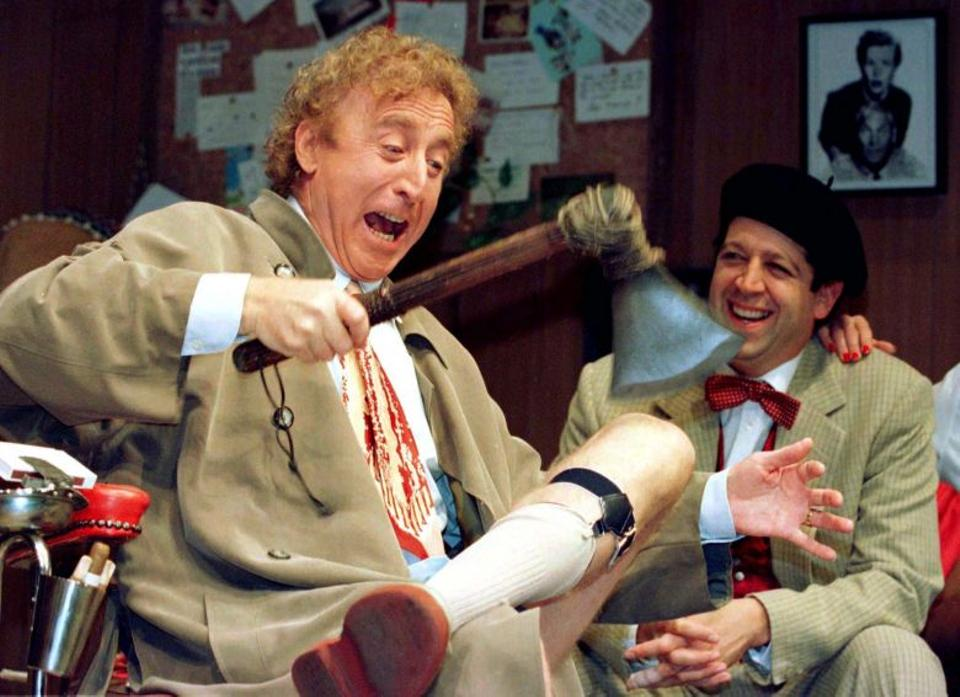 American actor Gene Wilder (L) who passed away on Monday can be seen in this photograph performing alongside actor Rolf Saxon during the rehearsal of a scene from Neil Simon's 'Laughter on the 23rd Floor', in New York, October 2, 1996.