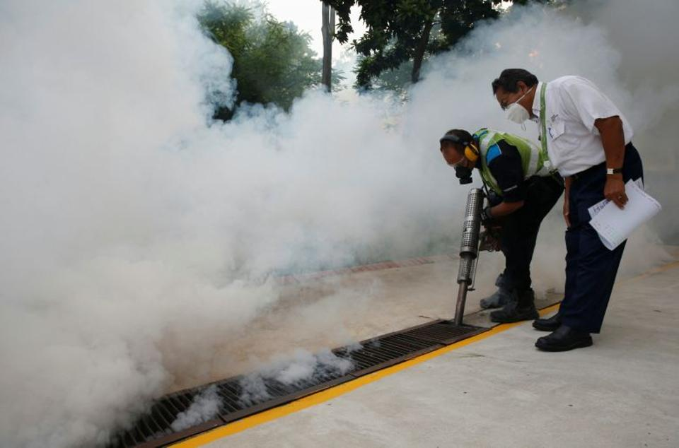 A worker fogs the drains in the common areas of a public housing estate at an area where locally transmitted Zika cases were discovered in Singapore August 31, 2016