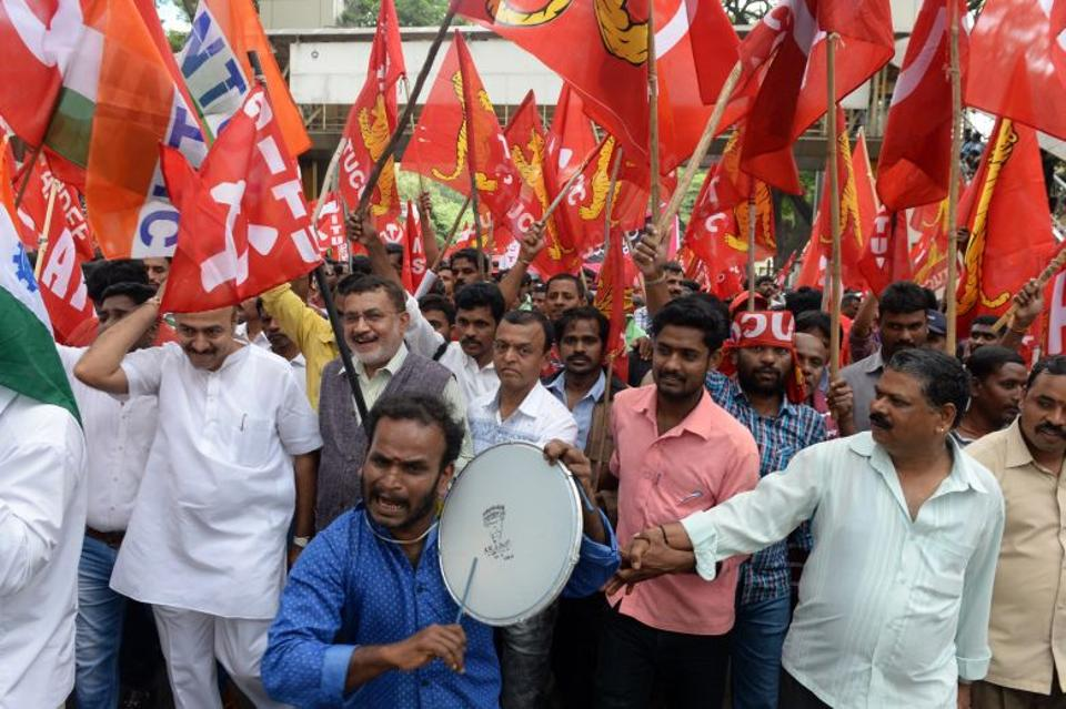 Indian industrial workers and activists of the Centre of Indian Trade Union (CITU) take part in a protest in Bangalore on September 2, 2016/AFP