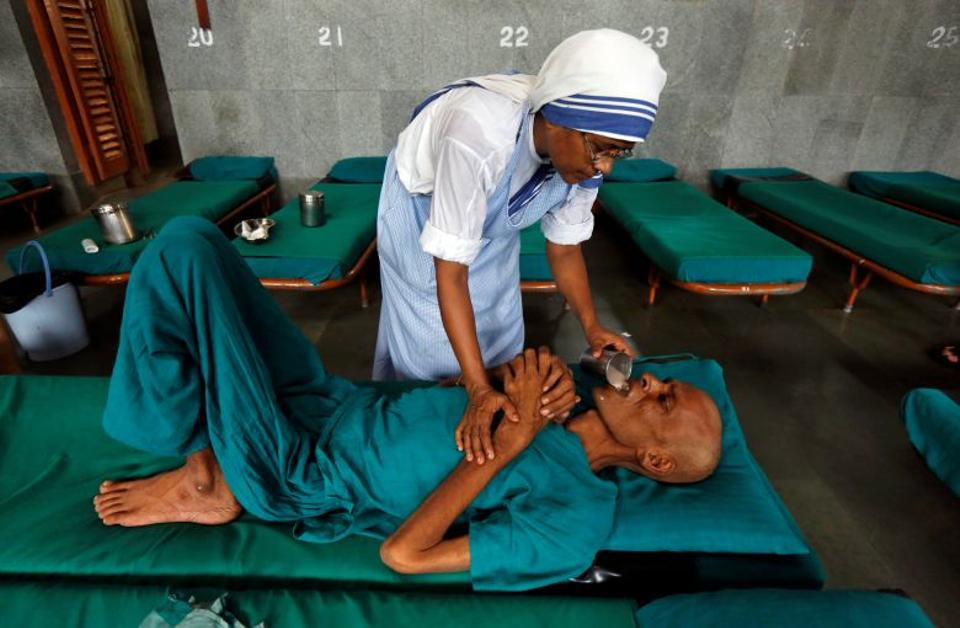 A nun belonging to the global Missionaries of Charity tends to a patient at Nirmal Hriday, a home for the destitute and old, founded by Mother Teresa ahead of Mother Teresa's canonisation ceremony, in Kolkata, India