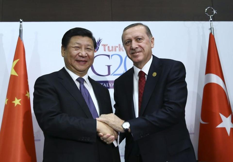 Turkish President Recep Tayyip Erdogan and Chinese President Xi Jinping shake hands following the signing of a treaty between the two countries in Antalya, Turkey, ahead of last year's G20 Summit.