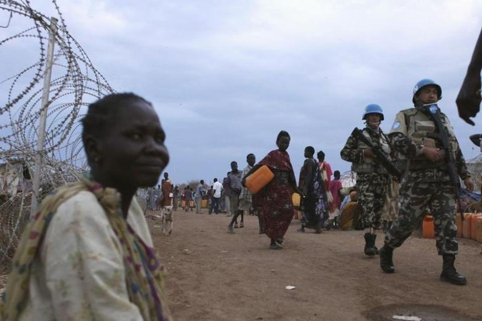 United Nations peacekeepers patrol in the camp for displaced people inside the United Nations Mission in South Sudan (UNMISS) compound in Malakal, Upper Nile State, which is currently held by anti-government forces, March 4, 2014.