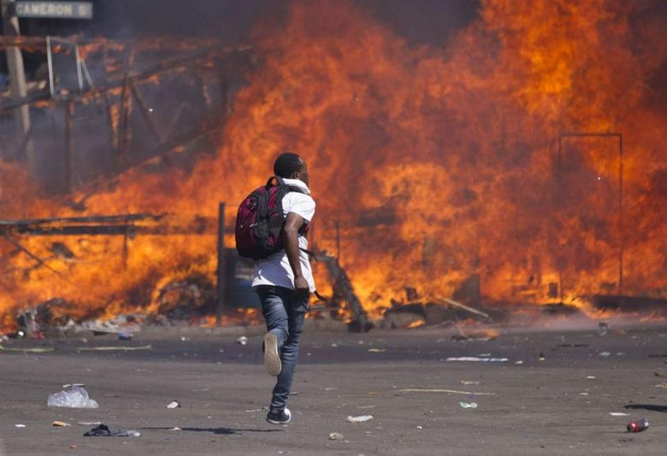 Zimbabwe's opposition supporters set up a burning barricade as they clash with police during a protest for electoral reforms on August 26, 2016 in Harare, Zimbabwe.
