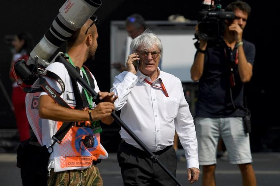 Formula 1 boss Bernie Ecclestone walks down the paddock after the first practice session at the Autodromo Nazionale circuit in Monza on September 2, 2016 ahead of the Italian Formula One Grand Prix.