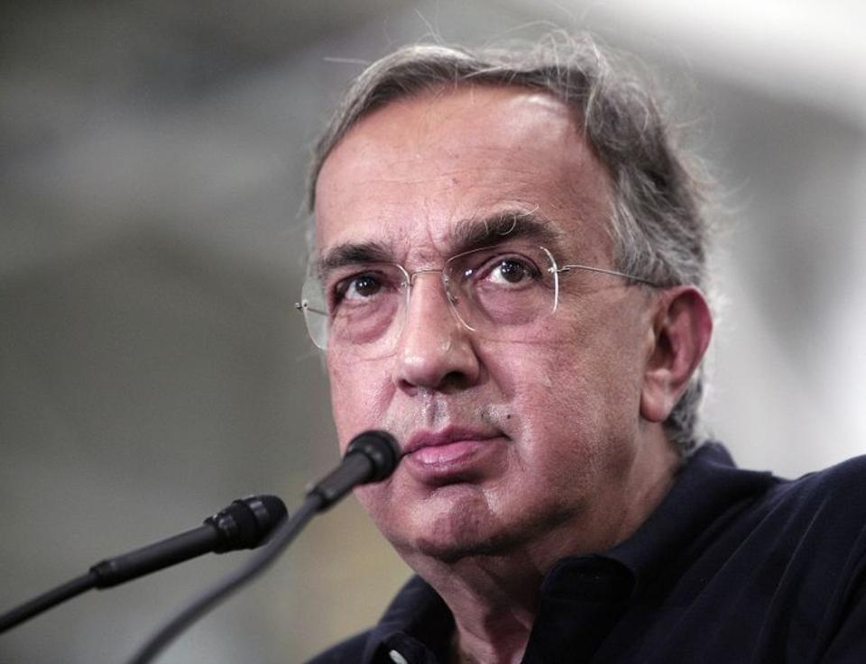Fiat Chrysler Automobiles CEO Sergio Marchionne answers questions after taking part in an event celebrating the start of production of three all-new stamping presses at the FCA Sterling Stamping Plant August 26, 2016 in Sterling Height, Michigan.