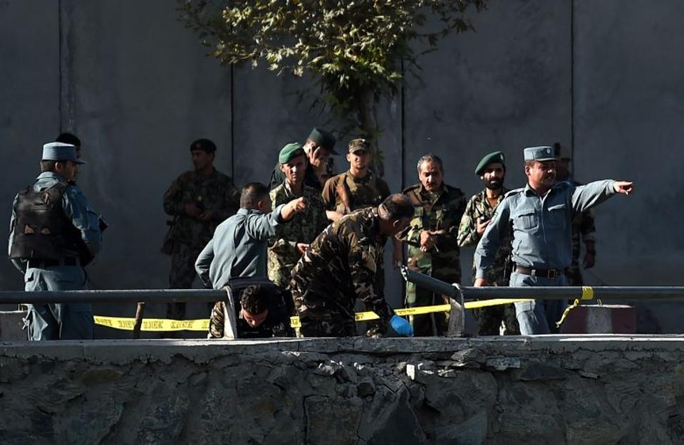 Afghan security personnel investigate the site of a twin suicide bombing near the Ministry of Defence in Kabul on September 5, 2016.