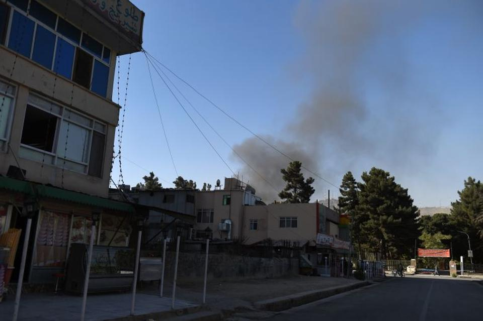 Smoke rises from a building during an attack on a charity at the Shar-e-Naw in Kabul on September 6, 2016.