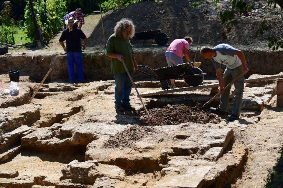 Workers remove soil at the tomb of Ottoman Sultan Suleiman the Magnificent, near Szigetvar.
