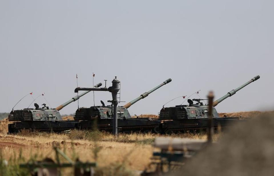 Turkish military tanks and armoured vehicles seen near Turkish-Syrian border in Gaziantep, Turkey during the