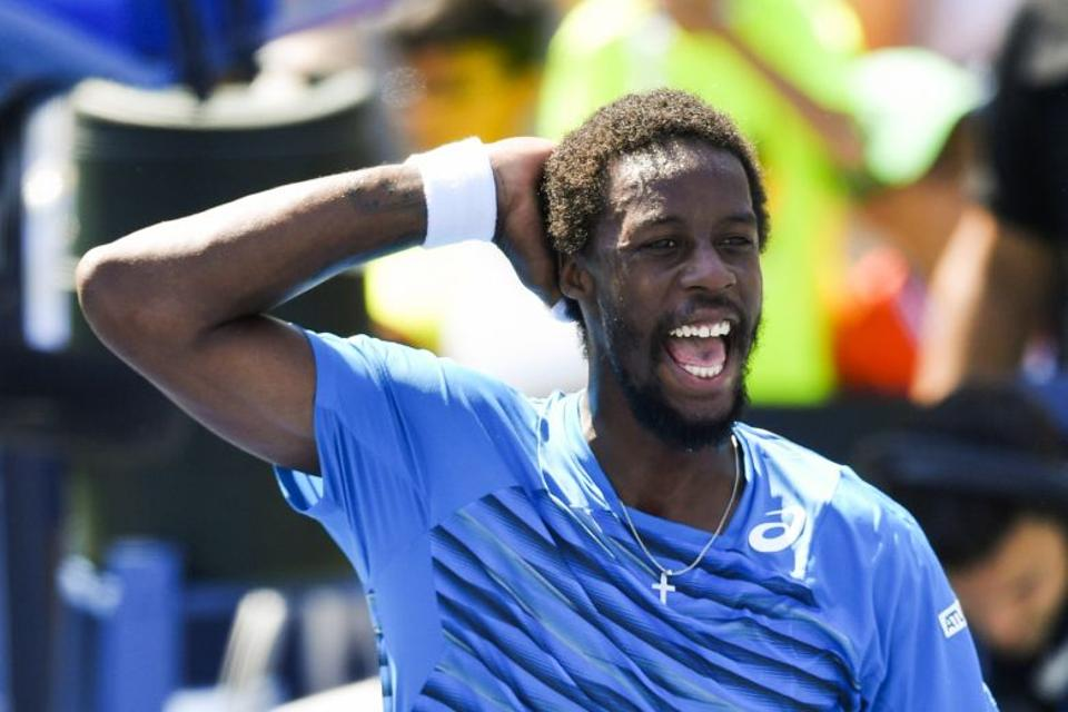 Gael Monfils of France reacts after defeating Marcos Baghdatis of Cyprus during their 2016 US Open Men's Singles match at the USTA Billie Jean King National Tennis Center in New York on September 4, 2016.